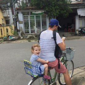 dad-and-happy-toddler-on-bicycle-hoi-an-vietnam